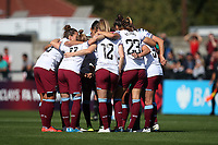 West Ham players huddle during Arsenal Women vs West Ham United Women, Barclays FA Women's Super League Football at Meadow Park on 8th September 2019