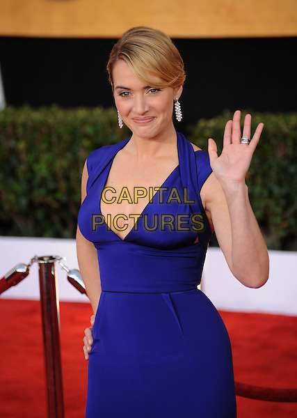 KATE WINSLET.The 15th Annual Screen Actor's Guild Awards held at The Shrine Auditorium in Los Angeles, California, USA..January 25th, 2009.Arrivals half length blue dress cleavage hand on hip palm waving dangling earrings SAG.CAP/DVS.©Debbie VanStory/Capital Pictures.