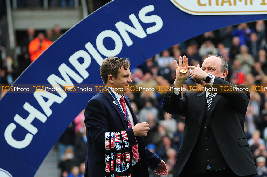 Newcastle United manager Rafa Benítez receives his winners medal and points to the fans during Newcastle United vs Barnsley, Sky Bet EFL Championship Football at St. James' Park on 7th May 2017