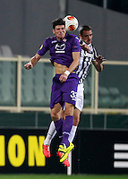 Calcio, ritorno degli ottavi di finale di Europa League: Fiorentina vs Juventus. Firenze, stadio Artemio Franchi, 20 marzo 2014. <br /> Fiorentina forward Mario Gomez, of Germany, and Juventus defender Leonardo Bonucci, right, jump for the ball during the Europa League round of 16 second leg football match between Fiorentina and Juventus at Florence's Artemio Franchi stadium, 20 March 2014. Juventus won 1-0 to advance to the round of eight.<br /> UPDATE IMAGES PRESS/Isabella Bonotto