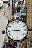 Clock on the front of Camden Lock Market Hall, London.
