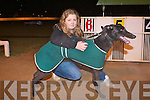 TOP DOG: Jessica Travis with Titan Tyrone winner of the first John & Mary Killeacle Dowling Memorial 570 Semi-Final in a time of 31:49 at the Kingdom Greyhound Stadium on Friday.