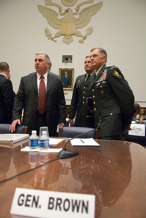 From left, former commander of the U.S. Central Command retired Gen. John Abizaid, and past commander of the U.S. Special Operations Command retired Gen. Bryan Brown wait at the witness table for the start of the House Oversight and Government Reform Committee hearing on the Pat Tillman fratricide on Wednesday, Aug. 1, 2007.