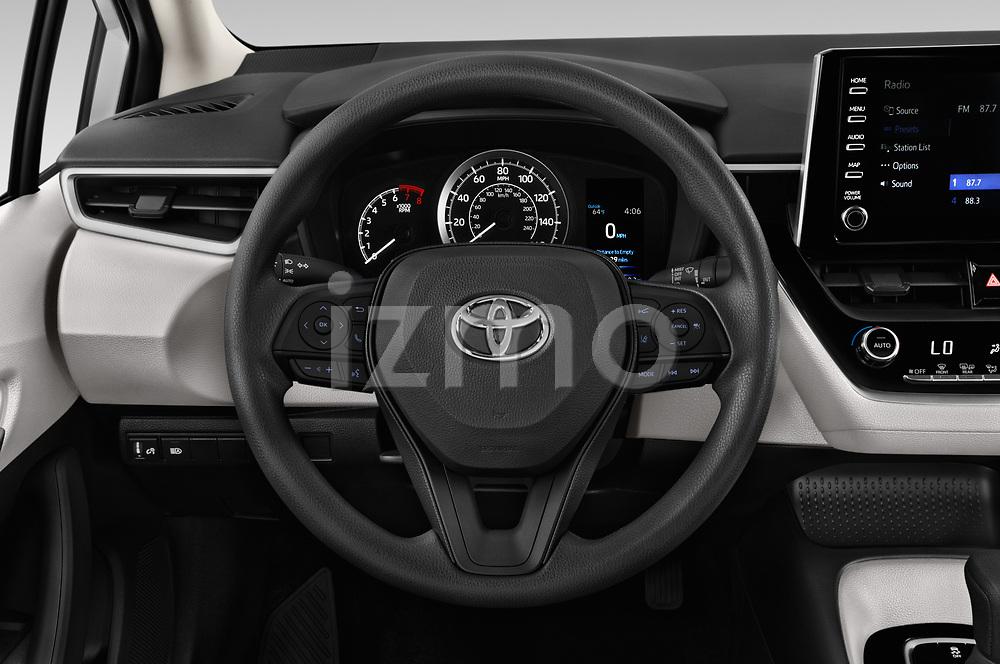 Car pictures of steering wheel view of a 2020 Toyota Corolla LE 4 Door Sedan Steering Wheel