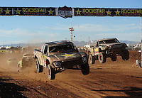Apr 16, 2011; Surprise, AZ USA; LOORRS driver Brian Deegan (38) races alongside Greg Adler (10) during round 3 at Speedworld Off Road Park. Mandatory Credit: Mark J. Rebilas-