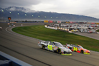 Feb 22, 2009; Fontana, CA, USA; NASCAR Sprint Cup Series driver Jimmie Johnson (48) races alongside teammate Jeff Gordon (24) for the lead during the Auto Club 500 at Auto Club Speedway. Mandatory Credit: Mark J. Rebilas-