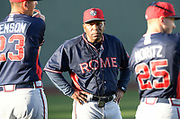 Veteran hitting coach Bobby Moore (1) of the Rome Braves watches his players warm up before a game against the Greenville Drive on Friday, April 19, 2019, at Fluor Field at the West End in Greenville, South Carolina. Greenville won, 2-0. (Tom Priddy/Four Seam Images)