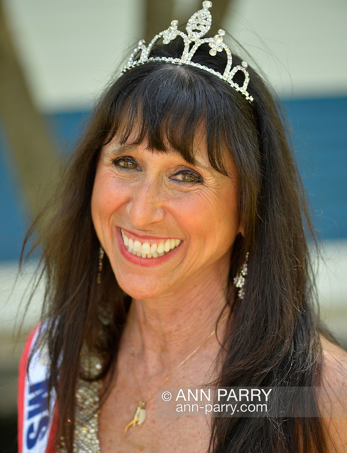 Merrick, New York, U.S. - May 26, 2014 - JANE RUBINSTEIN, Ms. New York Senior America, marches in The Merrick Memorial Day Parade and Ceremony, hosted by American Legion Post 1282 of Merrick, honoring those who died in war while serving in the United States military. Rubinstein is from Merrick.