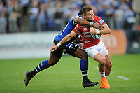 Semesa Rokoduguni of Bath Rugby tackles Henry Trinder of Gloucester Rugby during the Gallagher Premiership Rugby match between Bath Rugby and Gloucester Rugby at The Recreation Ground on Saturday 8th September 2018 (Photo by Rob Munro/Stewart Communications)