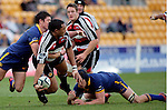 Sekope Kepu looks to offload  as he is brought to ground by Callum Bruce. Air NZ Cup game between Counties Manukau & Otago played at Mt Smart Stadium,Auckland on the 29th of July 2006. Otago won 23 - 19.