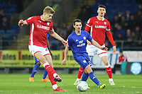 Brad Potts of Barnsley is challenged by Craig Bryson of Cardiff City during the Sky Bet Championship match between Cardiff City and Barnsley at the Cardiff City Stadium, Wales, UK. Tuesday 06 March 2018