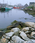 Halifax County, Nova Scota<br /> Fog on harbor at Peggy's Cove with exposed rocks at low tide