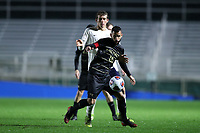 CARY, NC - DECEMBER 13: Bruno Lapa #10 of Wake Forest University plays the ball in front of Joe Bell #8 of University of Virginia during a game between Wake Forest and Virginia at Sahlen's Stadium at WakeMed Soccer Park on December 13, 2019 in Cary, North Carolina.