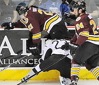 Chicago Wolves' Kevin Doell (21) and Mark Mancari (24) tangle with San Antonio Rampage's Wacey Rabbit along the boards during the third period of an AHL playoff hockey game, Saturday, April 21, 2012, in San Antonio. San Antonio won 4-3. (Darren Abate/pressphotointl.com)