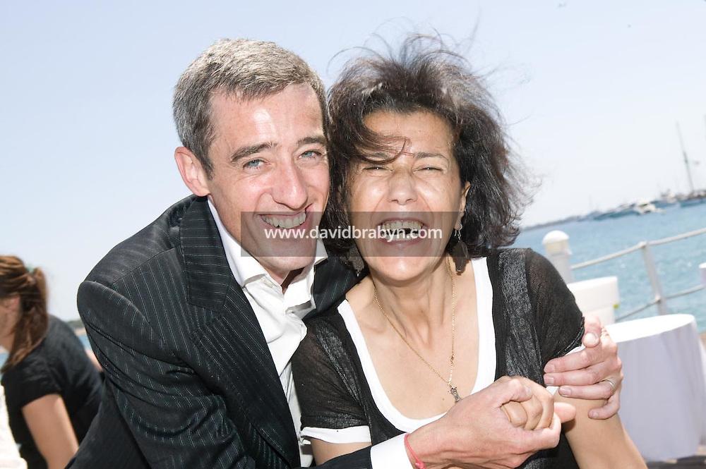 Gilles Duval (G), Yamina Bachir (D), dejeuner de presse, 20 ans de la Fondation Groupama-Gan pour le Cinema, Cannes, France, 18 mai 2007.