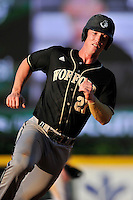 First baseman Brett Hash (27) of the Wofford Terriers heads for home in a SoCon Tournament game against Western Carolina on Wednesday, May 25, 2016, at Fluor Field at the West End in Greenville, South Carolina. Western won, 10-9. (Tom Priddy/Four Seam Images)