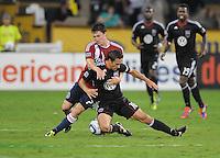 D.C. United forward Josh Wolff (16) gets fouled by Chivas USA midfielder Ben Zemanski (21). Chivas USA tied D.C. United 2-2 at RFK Stadium, Wednesday  September 20 , 2011.