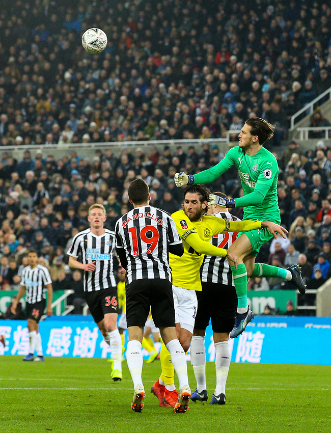 Newcastle United's Freddie Woodman punches clear under pressure from Blackburn Rovers' Danny Graham<br /> <br /> Photographer Alex Dodd/CameraSport<br /> <br /> Emirates FA Cup Third Round - Newcastle United v Blackburn Rovers - Saturday 5th January 2019 - St James' Park - Newcastle<br />  <br /> World Copyright © 2019 CameraSport. All rights reserved. 43 Linden Ave. Countesthorpe. Leicester. England. LE8 5PG - Tel: +44 (0) 116 277 4147 - admin@camerasport.com - www.camerasport.com