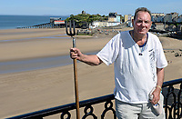 Pictured: Will Rossiter who created the political slogan on Tenby beach, Wales, UK.<br /> Re: A political slogan has been created on the North Beach of Tenby by local resident Will Rossiter.<br /> The slogan in the south Pembrokeshire town reads: Order of Command: Major Putin, Your Capt. Trump, Brexit Corporal Farage, Dream pte Boris BF Squad, S.O.S Vote Labour.