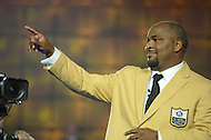 Canton, Ohio - August 1, 2014: Former NFL tackle Walter Jones gestures to the audience after donning his gold jacket during the Pro Football Hall of Fame's class of 2014 enshrinement dinner in Canton, Ohio  August 1, 2014. Jones was named to nine Pro Bowls during his career.  (Photo by Don Baxter/Media Images International)