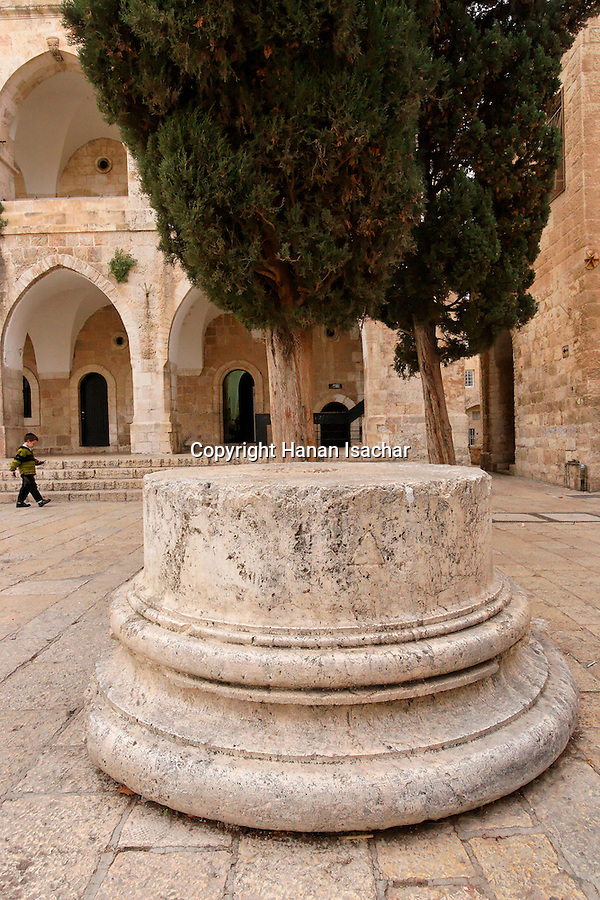 Jerusalem, Israel, The Jewish Quarter at the Old City. A Roman column base in Batei Makhase Square, the building was built in 1871 by the Rothchild family<br />