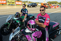 Oct. 5, 2012; Mohnton, PA, USA: NHRA pro stock motorcycle riders Eddie Krawiec (near) and Andrew Hines during qualifying for the Auto Plus Nationals at Maple Grove Raceway. Mandatory Credit: Mark J. Rebilas-