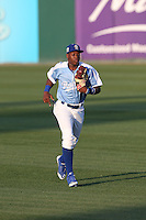 Johan Mieses (40) of the Rancho Cucamonga Quakes returns to the dugout during a game against the Stockton Ports at LoanMart Field on June 13, 2015 in Rancho Cucamonga, California. Stockton defeated Rancho Cucamonga, 14-2. (Larry Goren/Four Seam Images)