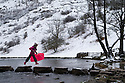 30/01/15<br /> <br /> Freya Kirkpatrick (7) crosses the stepping stones with her sledge at Dovedale after heavy overnight snowfall in the Derbyshire Peak District.<br /> <br /> All Rights Reserved - F Stop Press.  www.fstoppress.com. Tel: +44 (0)1335 418629 +44(0)7765 242650