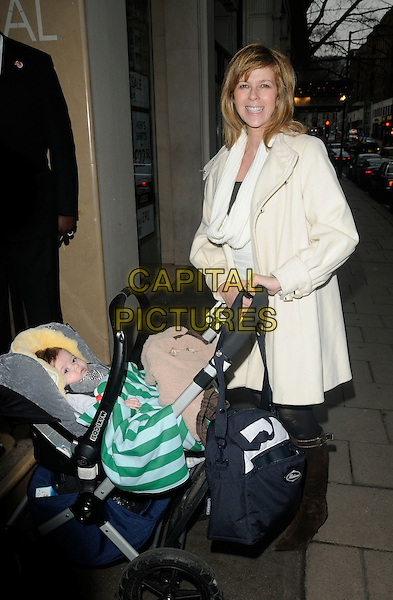 """KATE GARRAWAY & baby William Garraway Draper.At """"The Princess And The Frog"""" Gala Screening, Mayfair Hotel, London, England, UK, January 24th 2010..full length family child son cream white scarf coat buggy pushchair mom mum mother .CAP/CAN.©Can Nguyen/Capital Pictures"""
