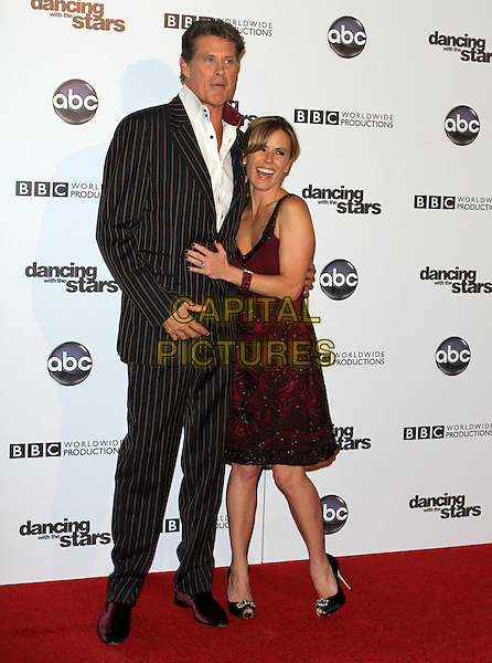 DAVID HASSELHOFF & TRISTA REHN.'Dancing With The Stars' 200th Episode held at Boulevard 3, Hollywood, CA, USA..November 1st, 2010.full length black red dress suit pinstripe white shirt.CAP/ADM/FS.©Faye Sadou/AdMedia/Capital Pictures.