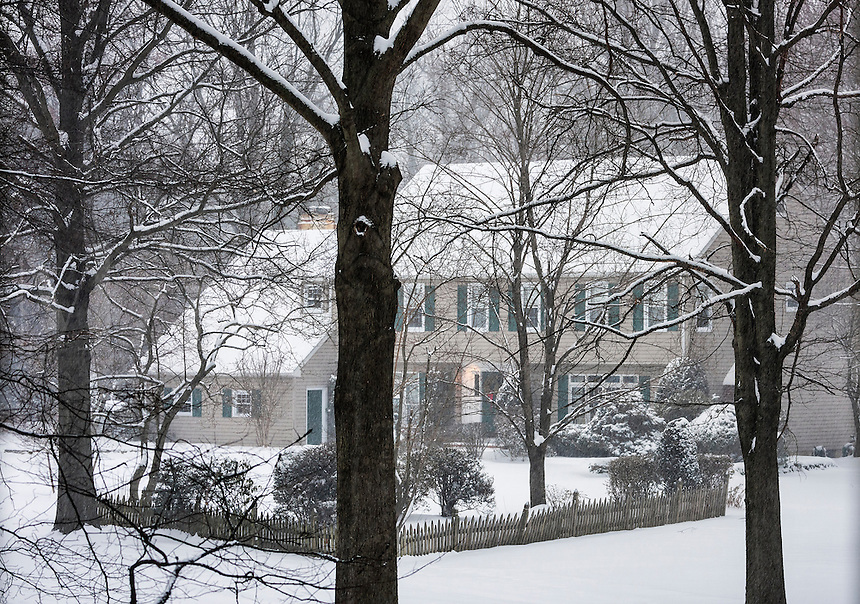Suburban house in winter snow storm, Moorestown, New Jersey, USA