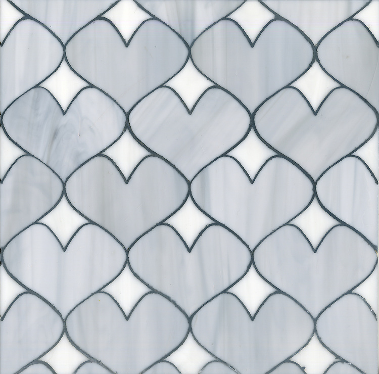 Hearts, a glass waterjet mosaic shown in Pearl and Moonstone, is part of the Erin Adams Collection for New Ravenna.