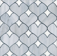 Hearts, a glass waterjet mosaic shown in Pearl and Moonstone, is part of the Erin Adams Collection for New Ravenna Mosaics.<br />