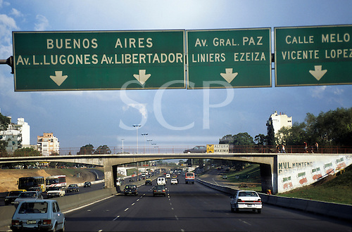 Buenos Aires, Argentina. Motorway with direction signs; Av L Lugones, Av Gral Paz Liniers Ezeiza, Calle Melo Vicente Lopez.