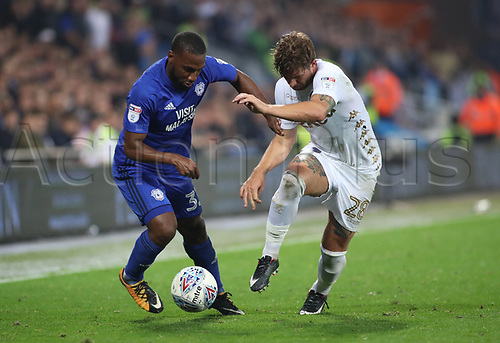 26th September 2017, Cardiff City Stadium, Cardiff, Wales; EFL Championship football, Cardiff City versus Leeds United; Junior Hoilett of Cardiff City and Gaetano Berardi of Leeds United battle for possession