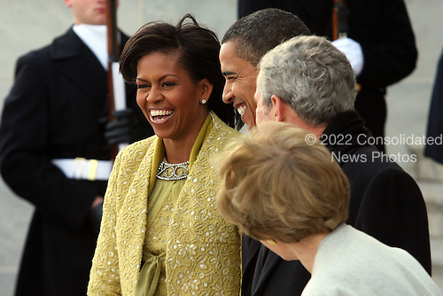 Washington, DC - January 20, 2009 -- United States President Barack Obama and his wife Michelle escort departing former United States President George W. Bush and his wife Laura to a waiting helicopter after the inauguration of Barack Obama as the 44th President of the United States of America, Tuesday, January 20, 2009 in Washington, DC. Obama becomes the first African-American to be elected to the office of President in the history of the United States. .Credit: John Moore / Pool via CNP
