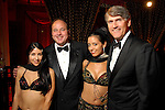 Belly dancer &quot;Zylona' played by Nicole Hanveya, chair MarkGrierson, &quot;Sahira&quot; played by Alesha Herrera and chair Mike Plank at the Children's Museum &quot;Arabian Nights&quot; Gala at The Corinthian Saturday  Oct. 14,2006.(Dave Rossman/For the Chronicle)<br />