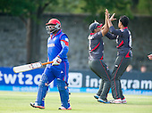 ICC World T20 Qualifier - GROUP B MATCH - AFGHANISTAN v UAE at Grange CC, Edinburgh - UAE celebrate the wicket of Afghanistan's Mohammad Shazad — credit @ICC/Donald MacLeod - 10.07.15 - 07702 319 738 -clanmacleod@btinternet.com - www.donald-macleod.com