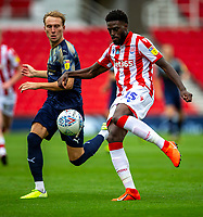 4th July 2020; Bet365 Stadium, Stoke, Staffordshire, England; English Championship Football, Stoke City versus Barnsley; Bruno Martins Indi of Stoke City clears the ball past Cauley Woodrow of Barnsley