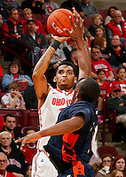 Ohio State Buckeyes forward LaQuinton Ross (10) takes a three pointer against Morgan State Bears guard Emmanuel Matey (10) during the 1st half of their game at The Value City Arena at the Jerome Schottenstein Center on November 9, 2013.  (Dispatch photo by Kyle Robertson)