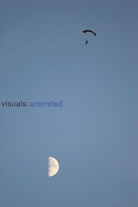 Parachutist and moon.