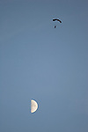 Parachutist and moon.
