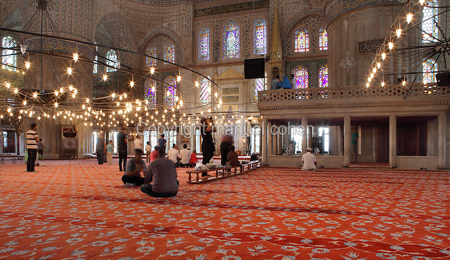 Prayer hall of the Sultan Ahmed Mosque (Sultan Ahmet Camii), or Blue Mosque, 1609-16, by Mehmet Aga, Istanbul, Marmara, Turkey. Built near the Hagia Sophia, the Blue Mosque combines Byzantine elements with Islamic architecture in the Classical Ottoman style. The blue tiles of the interior inspired its popular name. The historical areas of the city were declared a UNESCO World Heritage Site in 1985. Picture by Manuel Cohen.