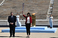 19th March 2020, Athens, Greece; The Olympic Flame, lit on Mount Olympia, is handed over officially to the  congregation from Japan, to be taken to Tokyo for the 2020 Olympic Games in July 2020. President of the Hellenic Olympic Committee SpyrCapralpasses the Tokyo Olympic flame to Imoto Naoko, an Olympian in swimming at the Olympic Games,  Atlanta 1996, at the Panathenaic stadium, in Athens