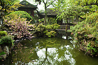 Couple's Retreat Garden is recognized with other classical Suzhou gardens as a UNESCO World Heritage Site.  The original garden was built by Lu Jin, prefect of Baoning district, in 1874. It was purchased by Shen Bingcheng, the magistrate of Susong. who rebuilt it in its current form. He also changed the name to the Couple's Garden Retreat. This name refers to the garden's two parts and alludes to a couple:  a cowboy and weaver girl. The garden is divided into an east and west section by the residential core in the middle; an unusual composition for a classical garden. The eccentric design is continued in the form and details of many of the garden buildings especially the Taosim Tower. The West garden is composed of several structures grouped around a small grotto and a Library annex. It is structurally joined to the central residence. East Garden is the main garden of the complex. It consists of a grotto and pond ringed by a covered walkway that connects the structures.