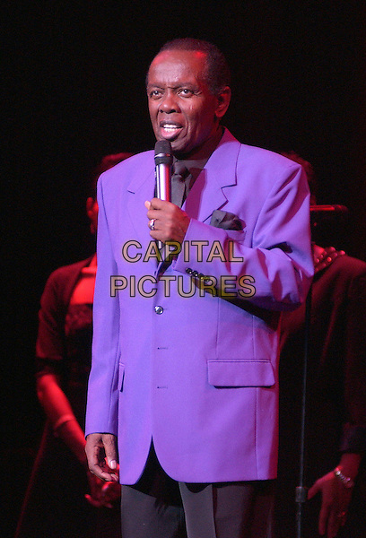 """LOU RAWLS .Sam Cooke Tribute Concert.File Photo November 6, 2005 - Cleveland, Ohio - Singer LOU RAWLS performs at the 10th Annual American Music Masters paying tribute to the late Sam Cooke presented by the Rock and Roll Hall of Fame and Case Western Reserve University held at the State Theatre, Playhouse Square. .January 6th, 2005.Cleveland, OH, USA; Singer Lou Rawls died of lung cancer and complications of pneumonia today (January 6th, 2006) at Cedars Sinai Medical Center in Los Angeles, his spokesman announced. Rawls was 72.  Last month it was revealed that the singer, whose many hits include """"You'll Never Find Another Love Like Mine,"""" was battling cancer of the lung and brain. .Photo: Jason Nelson/AdMedia/Capital Pictures.Ref: JN/ADM.half length purple jacket singing live gig performance music.www.capitalpictures.com.sales@capitalpictures.com.© Capital Pictures."""