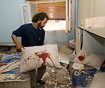 KHALID ELBARGHY,WITH BLOODSTAINED PILLOW FROM INJURED CHILDREN AFTER A BOMBING RAID BY GADAFFI FORCES THIS MORNING ON A RESIDENTIAL AREA OF THE CITY. THE BOMB EXPLODED ON THE ROOF OF THE ROOM WHERE THE CHILDREN WERE SLEEPING..HEI DOLLAR, BENGHAZI..19-3-2011 PIC BY IAN MCILGORM