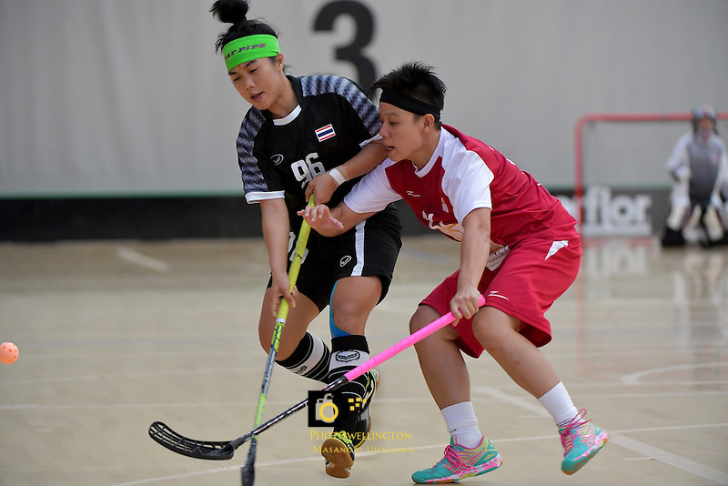 Thailand's Kanya Jantape and Singapore's Wilna Tant in action during the World Floorball Championships 2017 Qualification for Asia Oceania Region - Singapore v Thailand at ASB Sports Centre , Wellington, New Zealand on Sunday 5 February 2017.<br /> Photo by Masanori Udagawa<br /> www.photowellington.photoshelter.com.