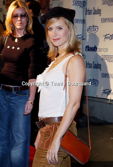 "Kelly Preston arriving at the party for the Paramount DVD Release of 70' movies """" Grease, Saturday Night Fever, Flashdance, Footloose, Urban Cowboy and Staying Alive """" on the back lot of the Paramount Studio in Los Angeles. September 24, 2002.          -            PrestonKelly29.jpg"