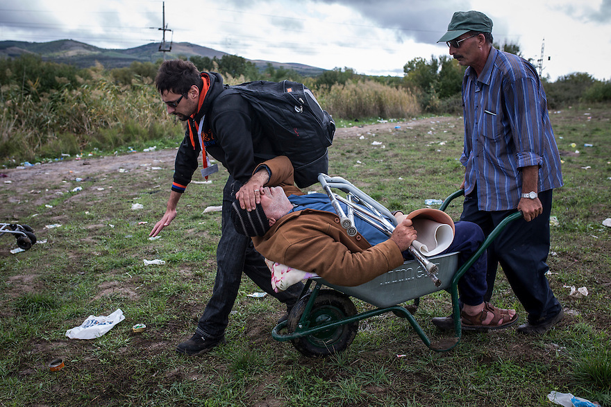 Families crossing through no-man's land between Macedonia and Serbia on October 11, 2015.